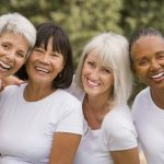 Multi-ethnic senior women laughing